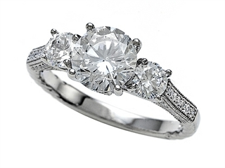 Zoe R Micro Pave Hand Set Cubic Zirconia (CZ) 3 Stone Engagement Ring with 7mm center.
