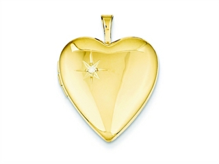 The beautiful 1/20 Gold Filled 20mm Diamond Heart Locket - Chain Included, crafted in 14 kt Yellow Gold Filled. This amazing design is set with 1 stone pave set Round Brilliant Diamond G color I1 clarity. This design measures 19.00 mm wide, 25.00 mm long.